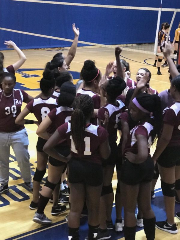 The volleyball team enjoying their win.