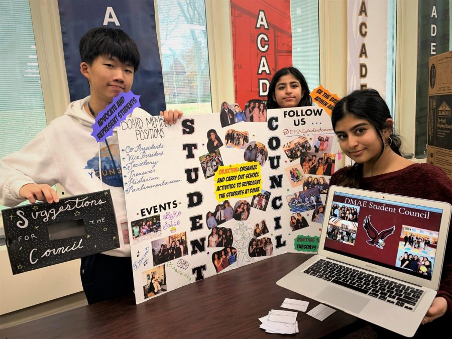 Students promote Student Council at Club Fair. Above, l to r: freshmen Woozoo Han and Ria Vij, and senior Khushi Panchal.