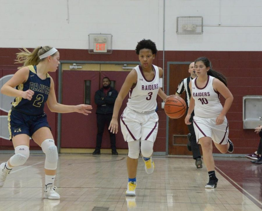 Senior Janesa Cockburn, center, and sophomore Blase Blakie, right, drive the ball at the Dwight Morrow home game vs. Indian Hills on January 9, 2020.